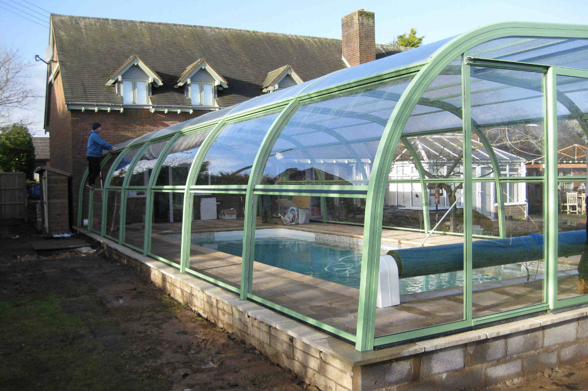 Galaxy Domestic Pool Enclosure Lean To Sliding End Doors and Lift Up Sides Light Green Being Installed