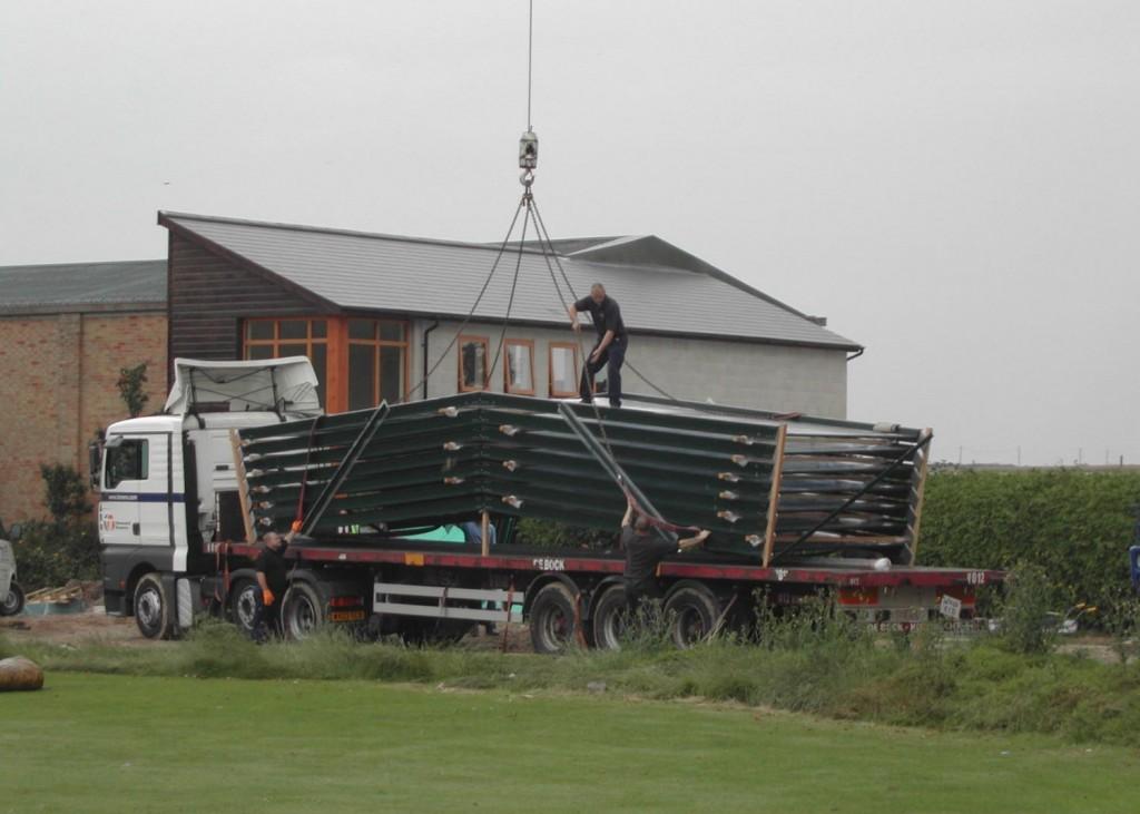 Using A Crane To Deliver A Pool Enclosure Building